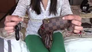 louis vuitton eva clutch what s in my bag and review