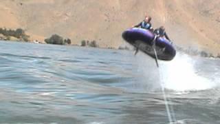Ski Boat Pulling a Tube.
