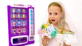 Nastya y papá fingen jugar con la máquina de dulces