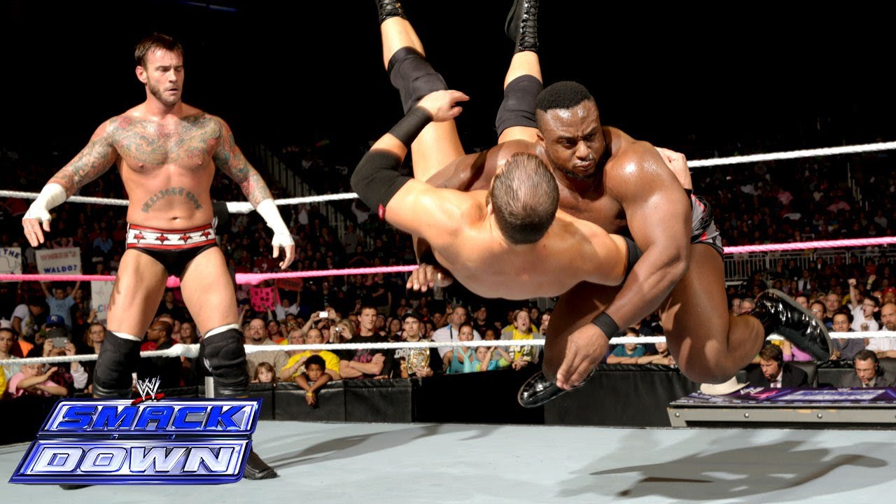 Big E Langston helps CM Punk repel a