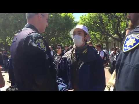 Police Remove Antifa power at Berkeley by forcing them to remove masks or go to jail.