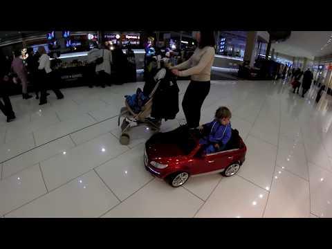Sasha Driving A Car At Otrada Shopping Centre