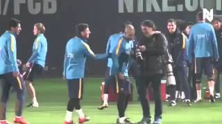 Messi nutmegs suarez during training session.