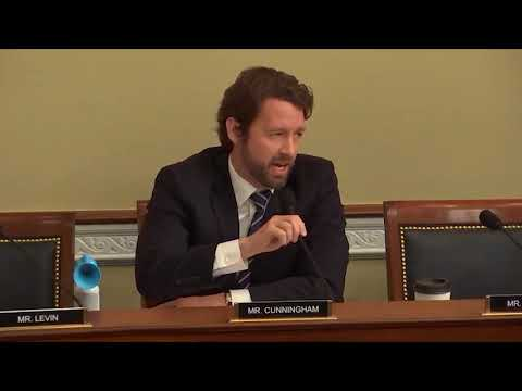 U.S. Rep. Joe Cunningham, D-SC blows an air horn in hearing