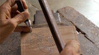 Tarkashi - A craftsman carving the design into a hard block of wood