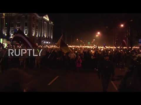 Latvia: Thousands hold Independence Day torch-lit procession through Riga