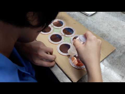 LOGO EMBLEM: Putting epoxy on the surface of the medals.