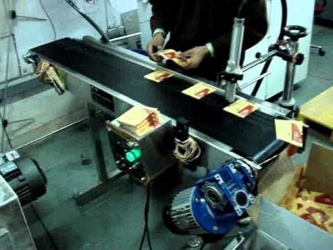 Ink Jet Coding Machine on Conveyor for Pouches Batch Printing