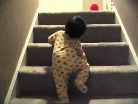 Cute 11 month baby going up and down stairs