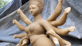 Unfinished clay sculptures of Indian Goddess Durga with ten hands - Durga Puja