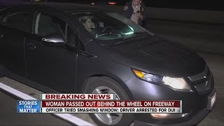 Woman passed out behind wheel on freeway