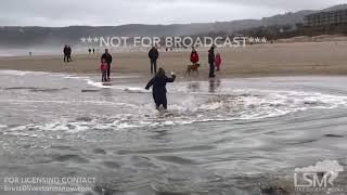 01-27-2018 Cannon Beach, Oregon - Sneaker Wave Engulfs Beachgoers