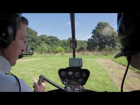R44 Helicopter cockpit view take off from private site with instructor explanations