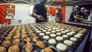Dutch Street Food. Cooking Sweet Pancakes Poffertjes with Chocolate