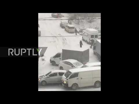 That's snow way to drive! Commuters fail to navigate slippery slope in Vladivostok