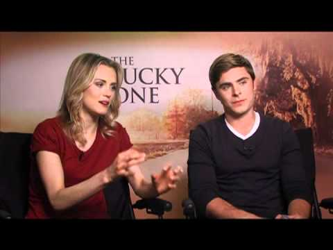 Zac Efron and Taylor Schilling Interview for THE LUCKY ONE poster