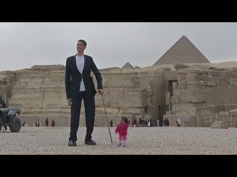The world's tallest man, Sultan Kosen, and the shortest woman, Jyoti Amge, Egypt's Giza Pyramids