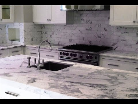 Mesmerizing White Grey Granite Countertop - YouTube on white laminate, white bathroom fixtures, white garages, white floors, white flooring, white lighting, white faucets, white baseboards, white tubs, white tile, white millwork, white lumber, white concrete, white gutters,