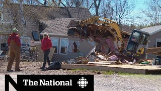 Flood forces couple to demolish retirement home