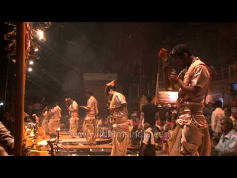 Ritualistic bell ringing creating an auspicious sound at Ganga Aarti in Varanasi