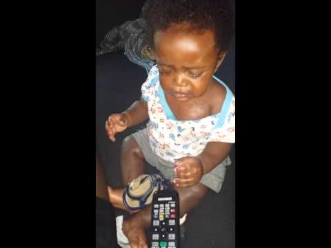 African baby eating chicken