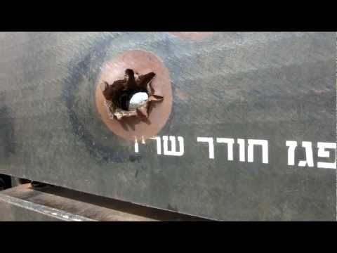 Holes by Russian Sagger Anti Tank missile and an Armor-Piercing shell