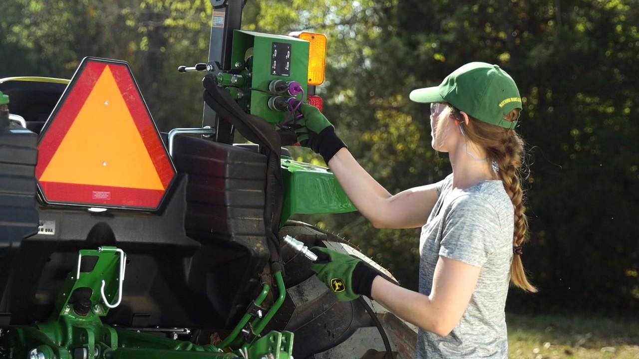 Maintain gravel drive using a box blade w/ hydraulic scarifiers