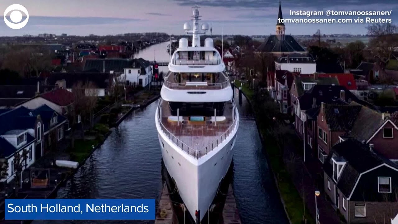 Yacht travels through small canal