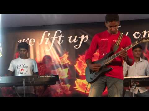 RENI ON GUITAR WITH HIS MAGIC HANDS - CHRISBROS MINISTRIES