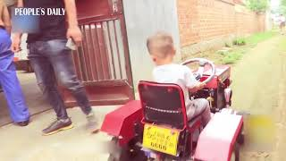 Creative daddy handmade a mini tractor for his 3-year-old son in E China