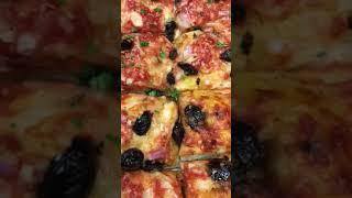 Oil cured olives fresh mozzarella crushed plum tomato