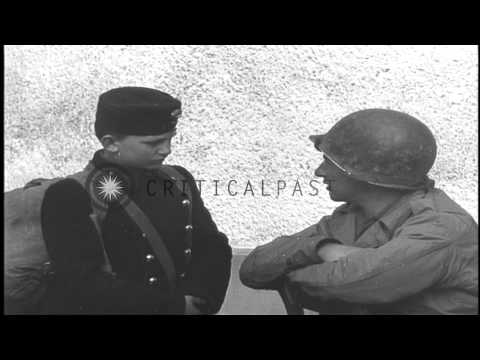 Hungarian schoolboys are interviewed by American soldiers of  US 11th Armored Div...HD Stock Footage
