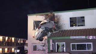 CAR FLIES INTO 2ND STORY OF A BUILDING