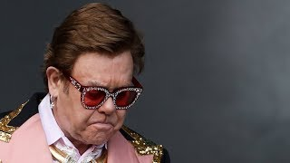 An emotional elton john had to cut short a performance in new zealand after he lost his voice due walking pneumonia and be assisted off stage.this ...