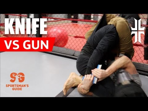 UFC fighter Brandon Davis in a gun&knife scenario in a tactical/defense training class.