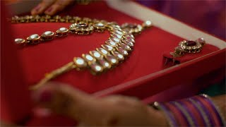 A female checking out kundan jewellery set / necklace set for festive preparation