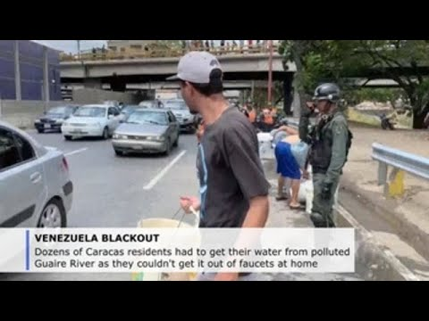 Caracas residents take polluted water from river thanks to power outage