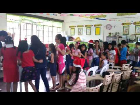 Typical Grade School Classroom and Students Christmas party celebration in the Philippines 3rd grade