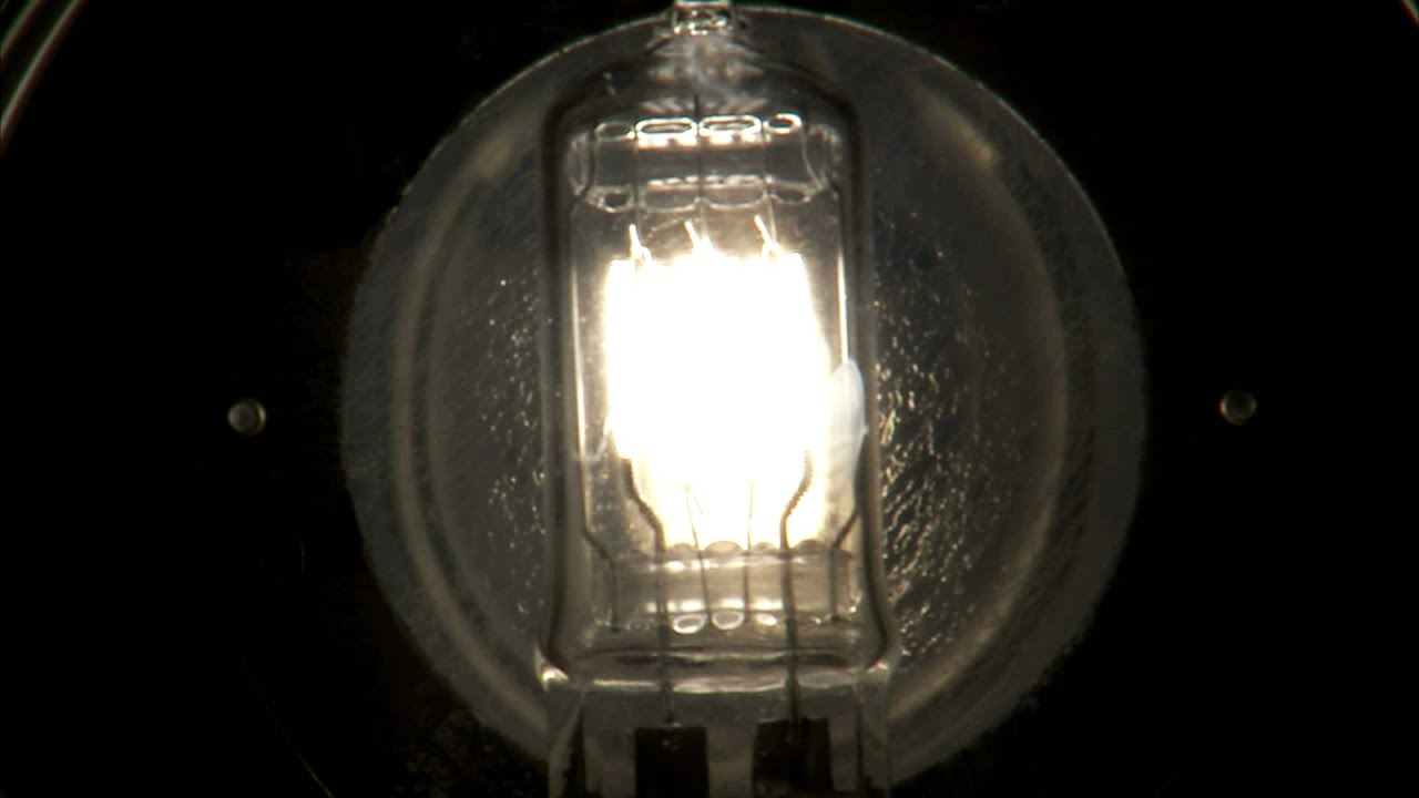 Close Up Of A Light Bulb With Several Filaments Flickering On Then Off