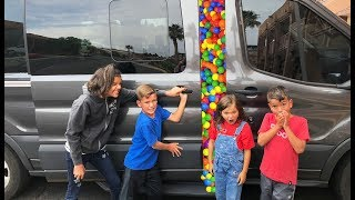 DIVING INTO BALL PIT BALLS IN THE VAN! candy hunt