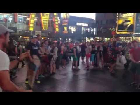 Three Irish lads hurling in the middle of Times Square