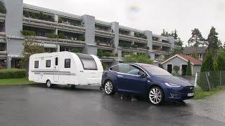 Model X towing a 1600 kg/3500 lb caravan