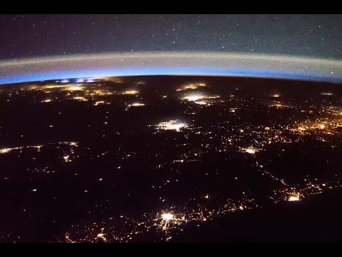 Lightning and 'Probably Satellites' Seen from Space Station