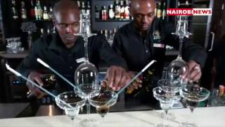 Mixologists create cocktails at Tune Hotel