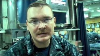 USS Porter Sailor answers a question about Navy uniforms