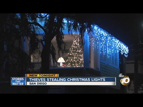 Thieves stealing Christmas lights
