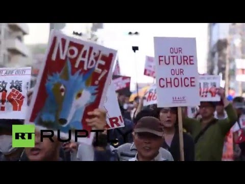 Japan: 'Smash fascism, Abe out!' Anti-govt protesters march through Tokyo