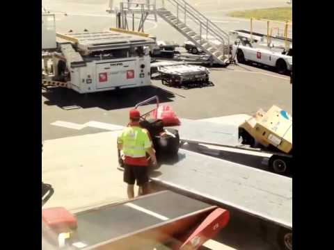 Australian plane getting its luggage loaded with fragile stickers