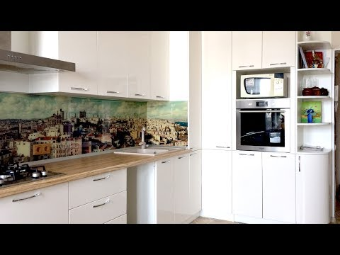 Белая кухня. Дизайн глянцевой угловой кухни