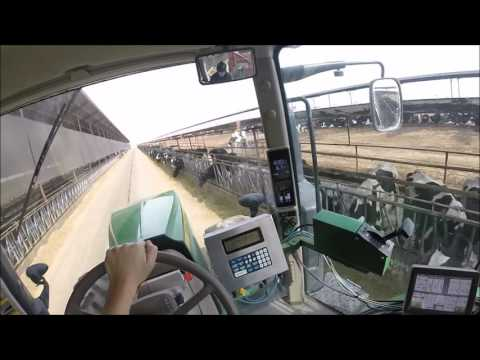 Unloading cattle feed John Deere 7r -- GoPro Head strap